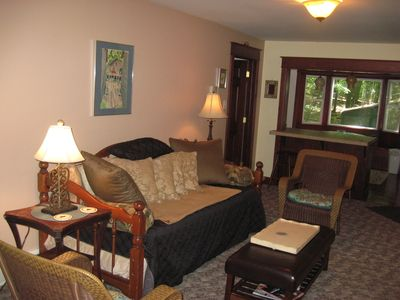 Living room has a daybed with a trundle that can be a king size bed or 2 twins.