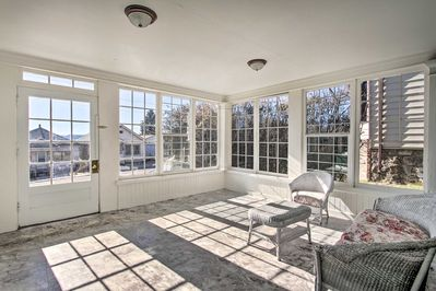This home features a sun room with large windows.