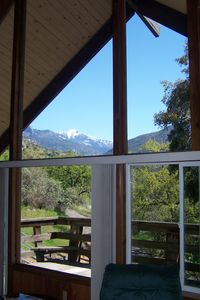 View of snow capped mountains from living room.