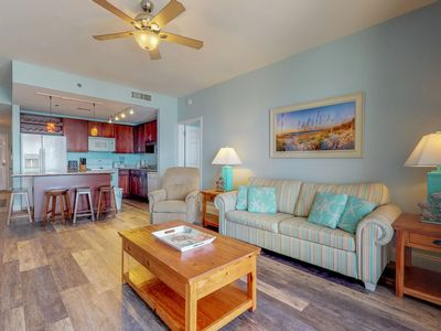 Photo for Lakefront condo with ocean views and shared pool only moments from beach & more!