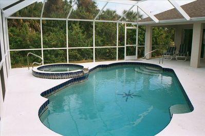 Private pool, spa and woodland view; lanai with loungers, dining table and BBQ