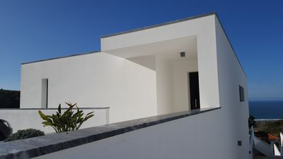 Photo for Recent modern villa (sleeps 8) with sea view and private pool, near Nazaré