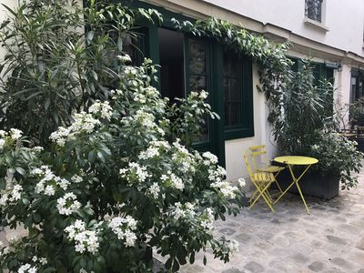 Photo for apartment courtyard with trees, in the heart of Paris