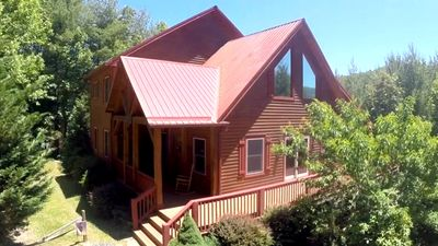 Photo for Houstons Haven - 4Br 3.5Ba - Hot Tub - Walk To The New River