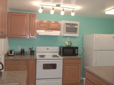 Brand new kitchen - 2015 - new stove, frig, cabinets, countertops, a/c unit, etc