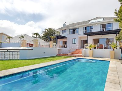 Photo for A contemporary home with a pool a minute from Camps Bay Beach