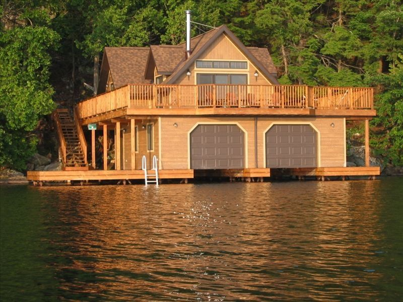 Luxury cottage and boathouse on skeleton lake in muskoka for Luxury lake house