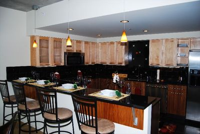 Fully equipped sparkling kitchen w/ Jenn Air appliances and granite counters.