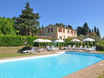 Photo for Cosy apartment with A/C, WIFI, pool, panoramic view and parking, close to Greve In Chianti