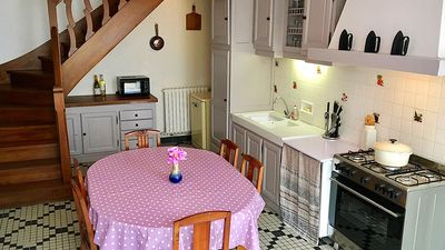 Fully equipped kitchen with large oven, dishwasher, microwave & butler sink.