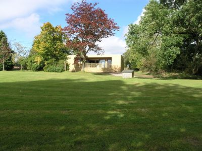 The Kist sits within our 6 acre garden, and looks south over the Fintry Hills.