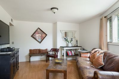 """Living Room - Relax in the living room with seating for 6 and a 42"""" TV. Complimentary Wi-Fi is provided."""
