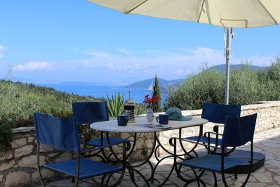 Al fresco dining with panoramic mountain and sea views