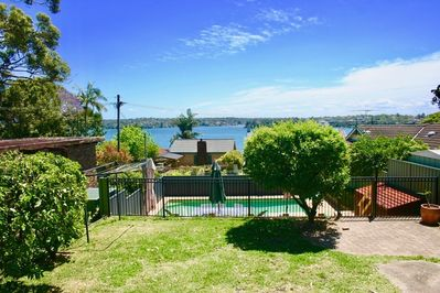 View from the rear of Bundeena Base. Fully fenced private garden & heated pool.