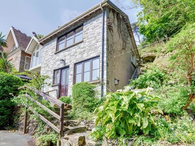 Photo for Cosy cottage on a hill with with a view of the beautiful coastal town Lynmouth