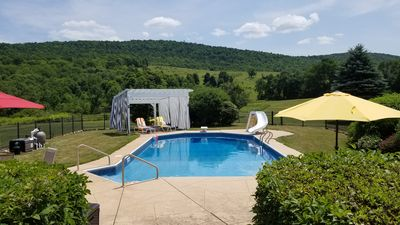 Photo for BEAUTIFUL PEACEFUL RUSTIC SETTING FOR 12+ Heated Pool Game Room Driving Range