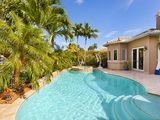 Ultra Modern 4 Bedroom Luxury Vacation Home on Waterway with Heated Pool