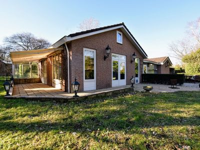 Photo for Spacious holiday home with open fireplace and sauna, located opposite 'Veluwse bossen' forest