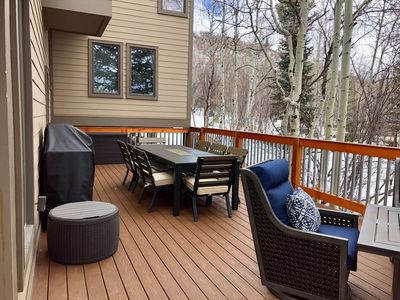 Huge deck with bbq, fire pit and seating for 8.