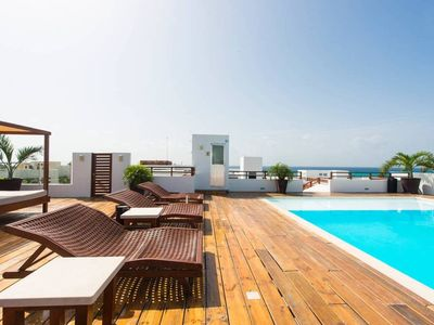 Photo for Luxury Condo step away from the sea