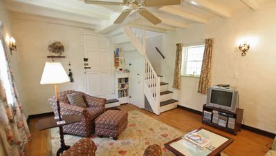 Living room with stairs to main bedroom.