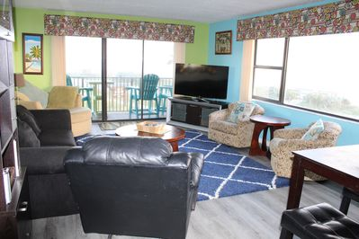 Large family room with tons of seating and new luxury floors throughout.