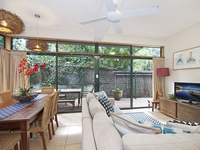 Photo for Palm Villa - Heated pool and walk to town