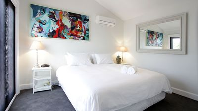 Photo for Stylish renovated heritage apartment, in quiet tree lined st close to the CBD