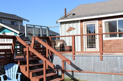 Large entry deck with seating to take advantage of views of Bay and lagoon.
