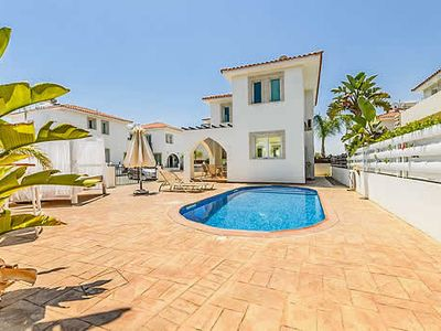 Photo for Modern and stylish villa near the bay w/ bbq, dining terrace and pool