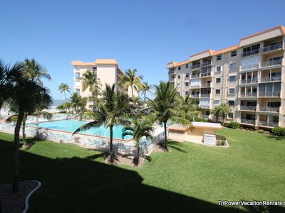 View from your condo of the pool, white sandy beach and Gulf of Mexico.