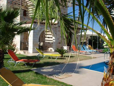 Green grass around the pool with plenty of Sun beds to Relax and enjoy the sun.