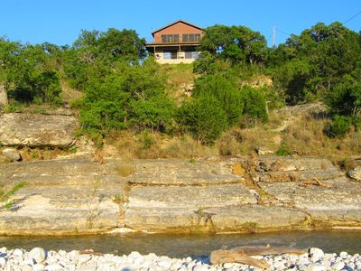 Lodge sits high above the river (swimming hole in foreground)