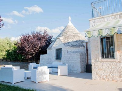 Photo for Trullo type rustic house with swimming pool and ample outdoor space.
