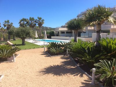 Photo for Stylish new 2bed garden apartment, pool, sea/sunset view. 5 minute walk to beach