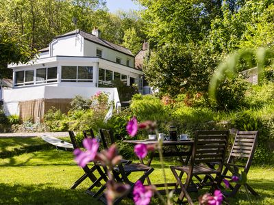 Photo for Award Winning Boutique Homestay - 5 mins to Beach. Garden set in Wooded Valley