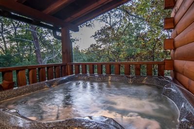 Have a private relaxing soak in the hot tub, surrounded by the trees