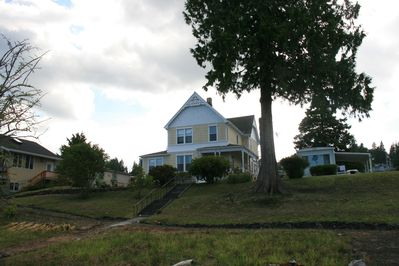 Mobile home is located next to a Victorian farmhouse built in 1900.