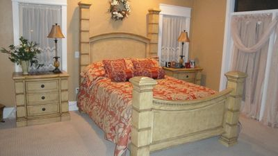 Master Bedroom King bed, Croshill linens, marble tops dressers, faces ocean on R