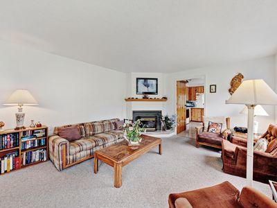 Photo for Classic home w/ fireplace & deck - 1/2 mile to beach, close to town!