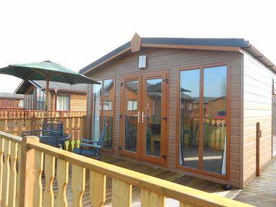 Lodge patio doors and decking close up