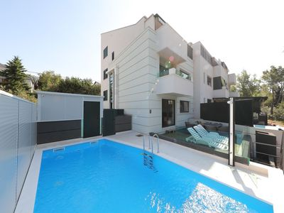Photo for Nice ground floor apartment with private terrace, shared pool 150m from the sea