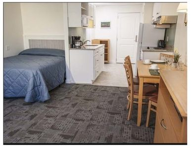 Full bed in unit 121, full kitchen, dining for 4 people, and queen sleep sofa.