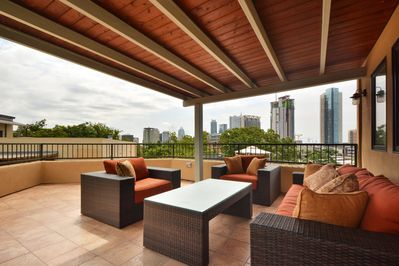 Rooftop Deck - Up the stairs from the main floor, you'll discover an amazing deck and lounge area overlooking downtown Austin.