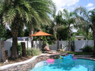 Our back yard tropical paradise oasis is waiting for  you. C'mon jump in!