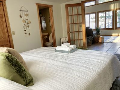 Master bedroom with a view of the lake or close the french doors for privacy.