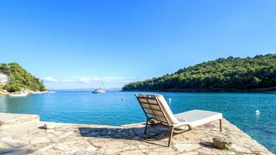 Photo for Sun terraces & large bathing terrace on crystal clear sea in a unique bay