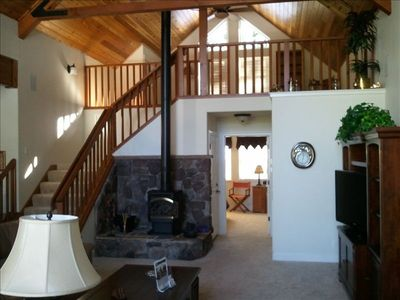 Open floor plan w/ private loft sleeps 3. Cozy up to the gas stove in winter.
