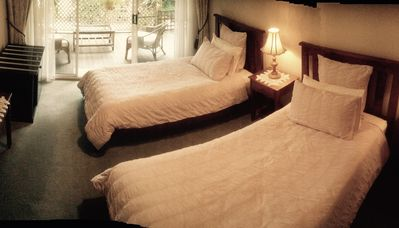 Photo for Orchid room with twin beds and verandah access