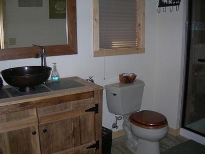 Great bathroom and Show in the first floor. Good for shower before hot tub
